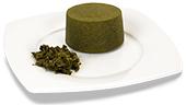 Passierte Grünkohl-Timbale, auf einem Teller angerichtet