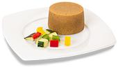 Passierte Ratatouille-Timbale, auf einem Teller angerichtet